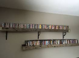 Dvd Shelves Woodworking Plans by Best 25 Dvd Rack Ideas On Pinterest Dvd Storage Rack Diy Dvd