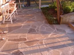 How To Lay Patio Pavers On Dirt by Flagstone What To Use Sand Cement Or Gravel Devine Escapes