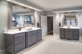 modern gray bathroom vanities among sinks on two wall sides of the