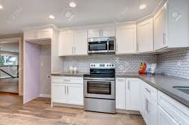 what tile goes with white cabinets open concept kitchen with white cabinets grey quartz countertops