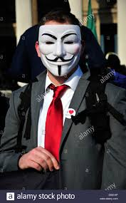 anonymous mask a with a tie wearing an anonymous mask at a rally in stock