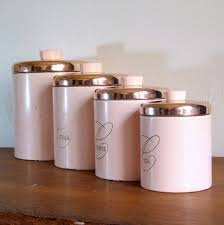 vintage canisters for a kitchen in pastel pink colors