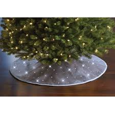 Twinkling Christmas Tree Lights Canada by The Cordless Twinkling Tree Skirt Hammacher Schlemmer