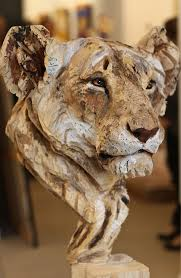 wood sculpture by chainsaw artist jurgen lingl rebetez carving