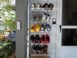 white tiered hanging garage shoe storage behind the door decofurnish