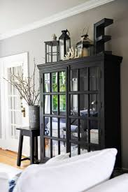 thoughts on decorating the top of an armoire decorating