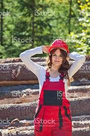 young woman in work clothes and helmet stock photo 520122882 istock