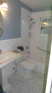 bathroom wall sconces with wall decor also floating sink and