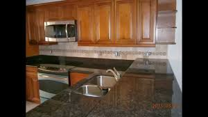 Black Glazed Kitchen Cabinets Caramel Glazed Kitchen Cabinets With Black Granite West Palm