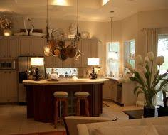 Decorating Above Kitchen Cabinets Use Items That Have A Particular Theme Or Color Maybe You Love