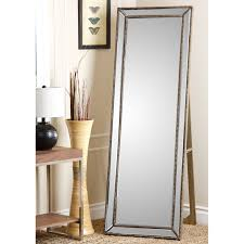 furniture floor leaner mirror with side table and brown rug for