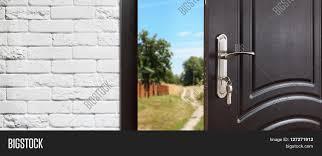 entrance door half opened to nature background door handle door