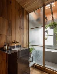 smoked oak and rustic clay line walls of japanese styled apartment