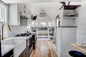 beautifully designed tiny house with luxury kitchen and spacious