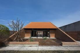 modern brick house light and shadow help shape this modern brick house in vietnam dwell