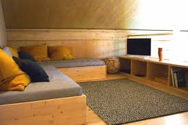 a large bedroom and tv lounge