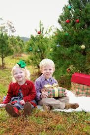 christmas mini sessions at a christmas tree farm child