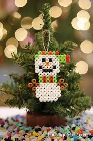 perler bead ornaments housing a forest