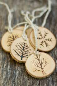 tree branch christmas ornaments wood burned trees and snowflakes