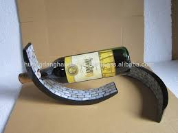 Single Wine Bottle Holder by Balances Wine Bottle Holder In Mid Air Lacquer Wood Wine Arc