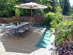 kitchen backyard decor with lush plants also wooden chairs and