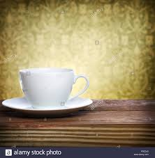 coffee cup over fancy wallpaper background stock photo royalty