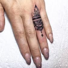 13 tattoos prettier than your flashy rings ring tattoos