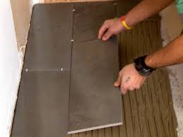 Laying Ceramic Floor Tile How To Install A Plank Tile Floor How Tos Diy