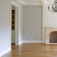whitewashed wood floors yellow couch white walls clean meets warm