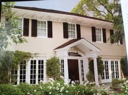 painting of attractive houses with shutters that will be the