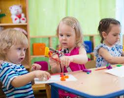 kids group making arts and crafts in kindergarten children