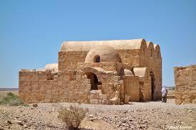 jordan iii black blue and green life near water in the desert qasr amra