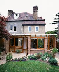london country chic exterior contemporary with exposed brick