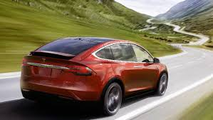 tesla to start selling lower cost model 3 car on friday cbs news