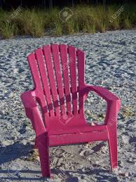 Plastic Beach Chairs Bright Pink Colorful Adirondack Chair On Beach Stock Photo