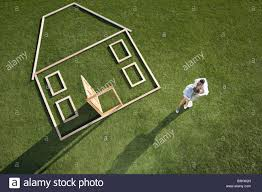 couple standing next to house outline stock photo royalty free