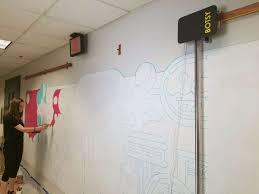 uf alumna puts botsy a mural making robot to work news mural bot