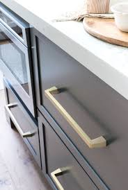 white kitchen cabinets with gold pulls my kitchen remodel reveal driven by decor
