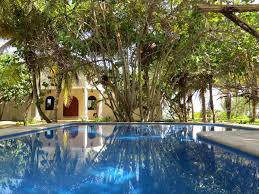 mediterranean style house in a 2 acre coconut plantation telchac