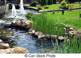 garden with river artificial river with rocks and green stock