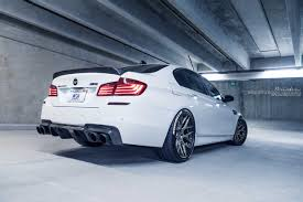 bmw white car alpine white bmw m5 with tire stickers