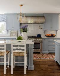 blue gray for kitchen cabinets blue gray kitchen cabinets with antique brass hardware