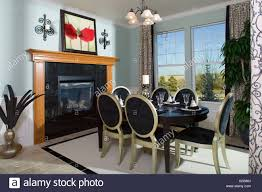 dining room and table middle class home interior stock photo