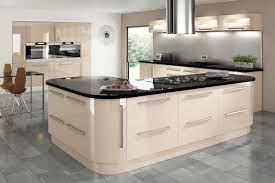 cream gloss kitchen with integrated handle and granite worktop