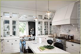 ash wood driftwood glass panel door lighting over kitchen island