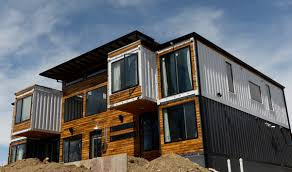 100 shipping containers converted to homes shipping