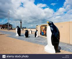 ornamental statues of penguins on the seaside promenade at redcar