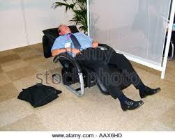 man asleep on vibrating chair stock photo royalty free image