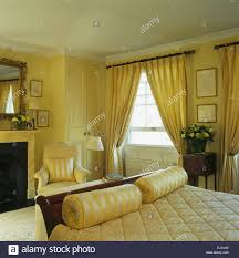 bolster stock photos bolster stock images alamy yellow silk bolster cushions at the foot of the bed in yellow townhouse bedroom with yellow