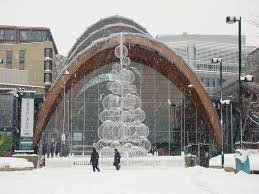 xmas tree sculpture and winter garden from a snowy tudor square